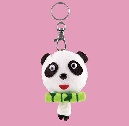 Baby Panda Keyring - lobster claw keyring attachment. large black and white panda head with smaller sized string doll body. the panda carries a green felt piece of bamboo