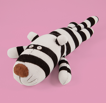 Tiger Soft Toy - black and white sock toy in the shape of a sleeping tiger