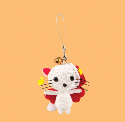 String Doll Christmas decoration in the shape of a white cat wearing red wings and carry a wand