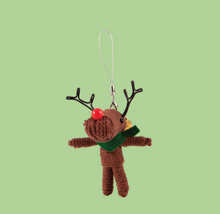 string doll christmas decoration in the shape of a small deer, brown in colour