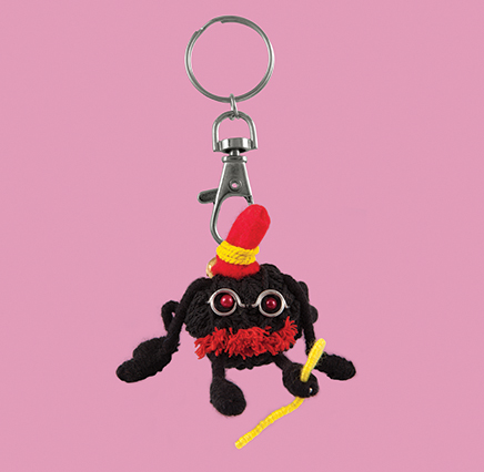 black spider keyring wearing top hat and carrying a walking stick