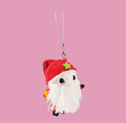 white string doll christmas decoration in the shape of santa claus wearing a red santa hat